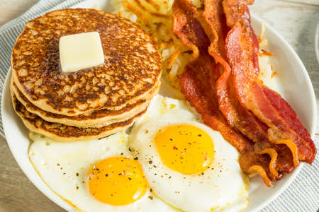 84631255-healthy-full-american-breakfast-with-eggs-bacon-and-pancakes
